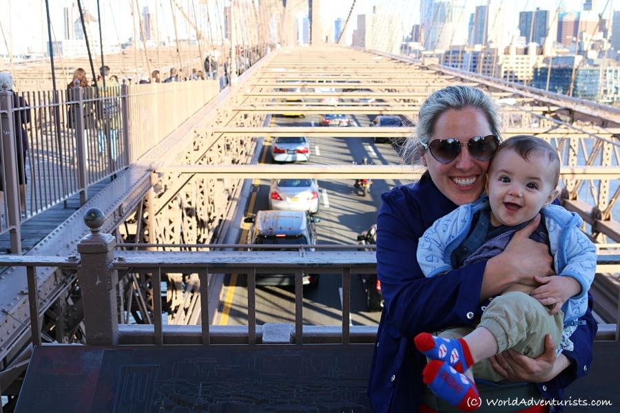 Smiling baby on the Brooklyn Bridge