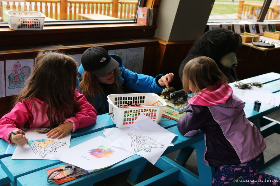 Kids enjoying some learning with the tour guide at Sunshine Meadows