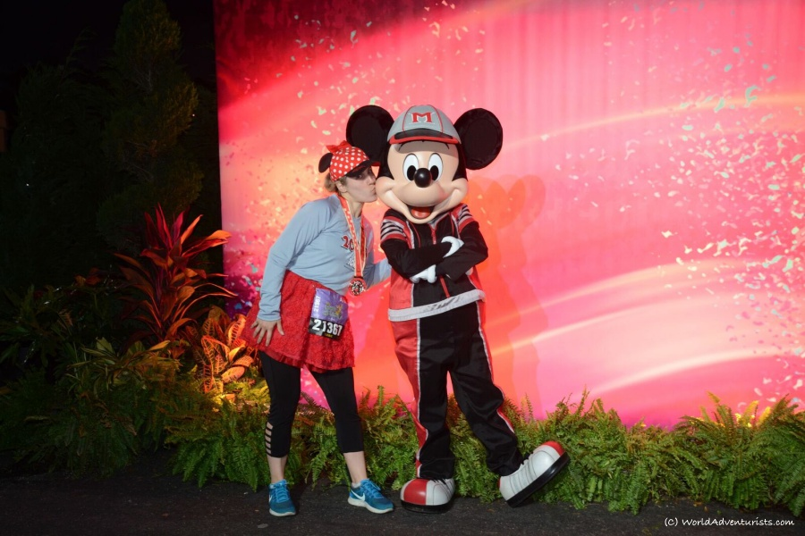 Girl kissing Mickey mouse at Run Disney event