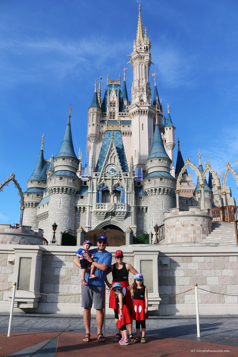 A family photo in front of the castle at Disney World.