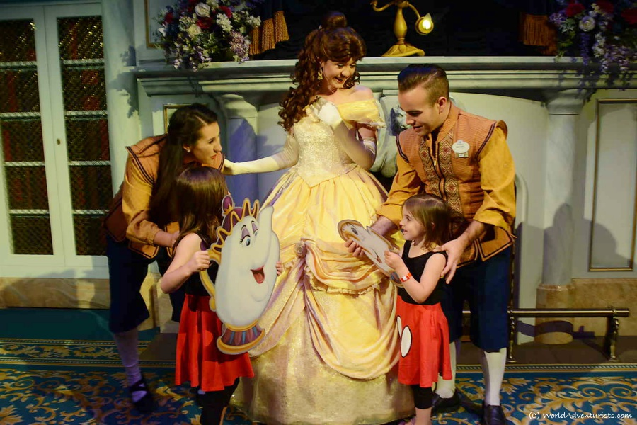 Little girls part of the Beauty and the Beast story at Disney World