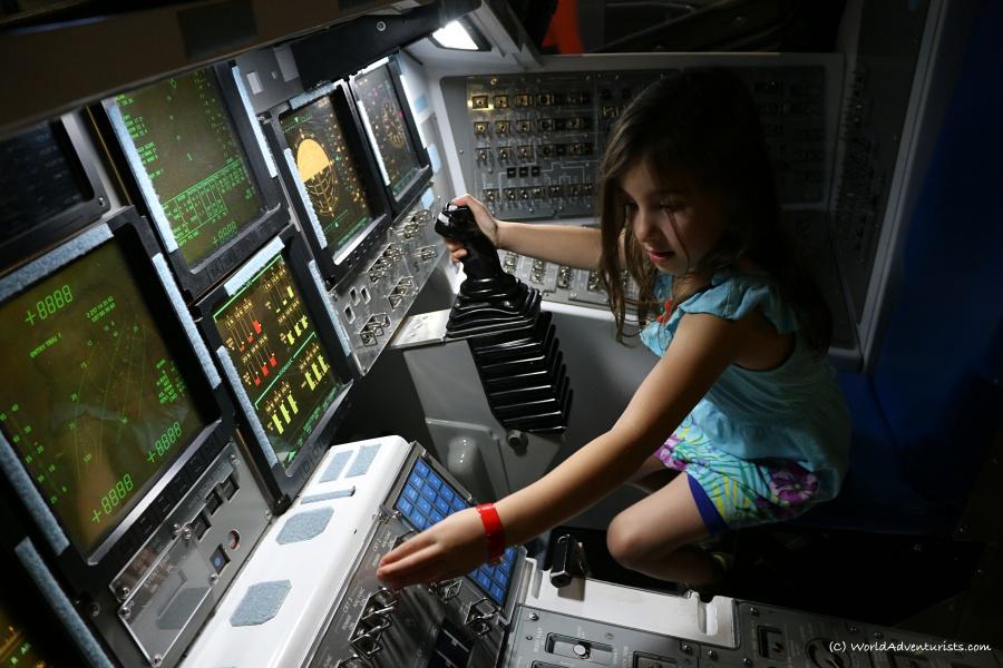 Little girl exploring at NASA's Kennedy Space Center