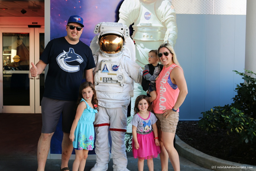 Family photo with an astronaut at NASA's Kennedy Space Center