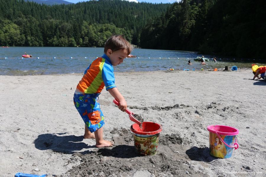 Digging in the sand at Alice Lake in Squamish