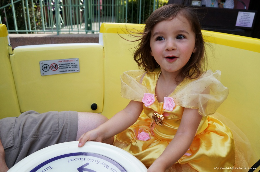 Little girl enjoying her ride in a tea cup