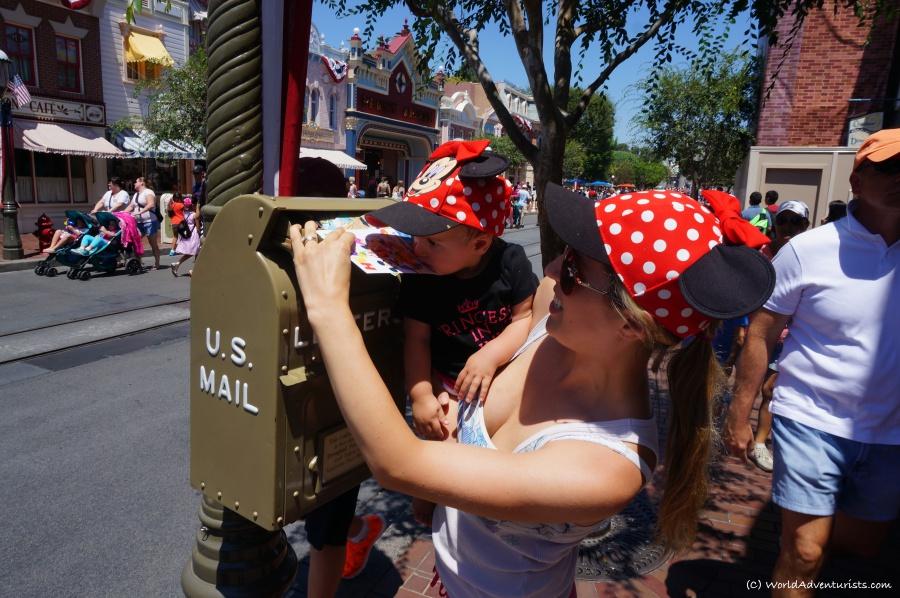 Mailing postcards at Disneyland