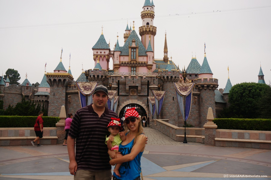 Family photo in front of the castle at Disneyland