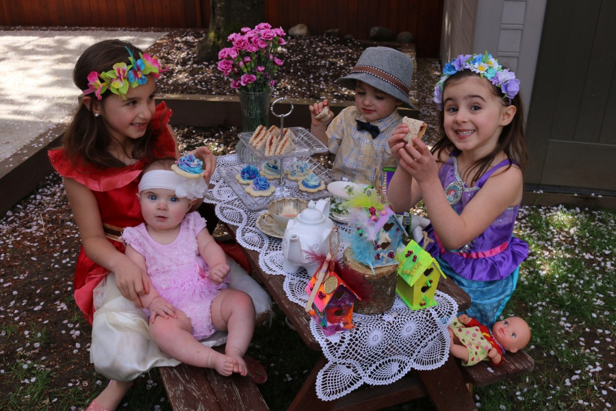 Kids having a fairytale tea party