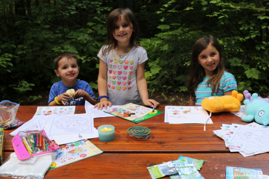 Kids smiling and colouring, camping at Wells Gray Provincial park