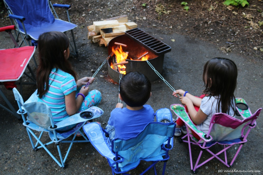 Kids roasting hotdogs while camping at Wells Gray Provincial park