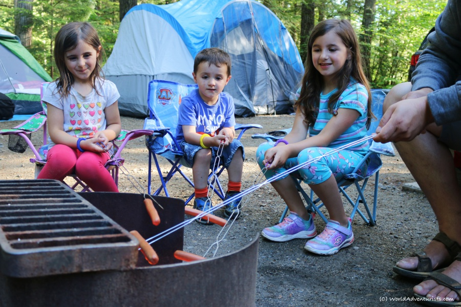 Kids roasting hot dogs while camping at Wells Gray Provincial park