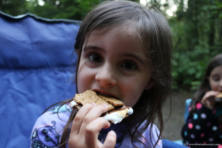 A young girl enjoying a s'more while camping at Wells Gray Provincial park