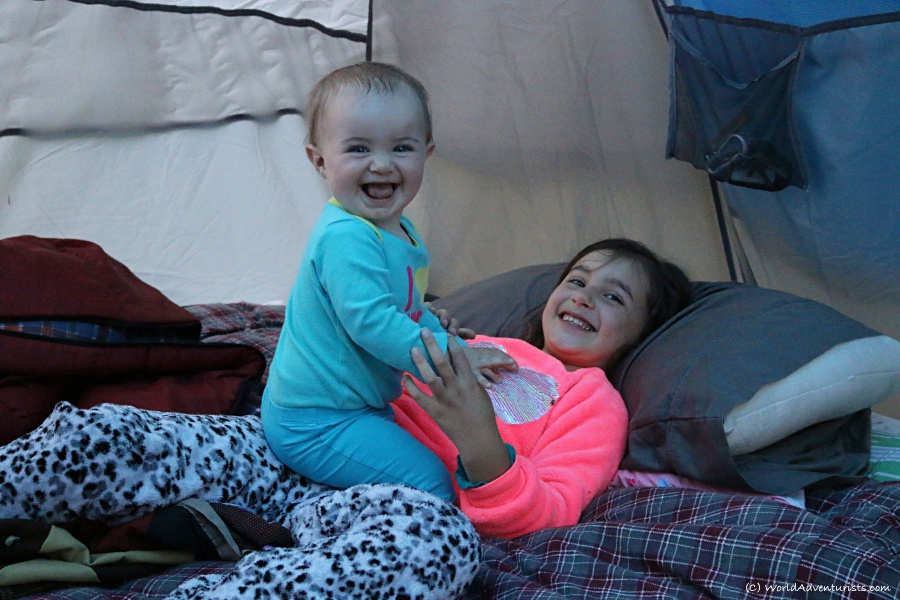 Happy sisters in a tent at Wells Gray Provincial park