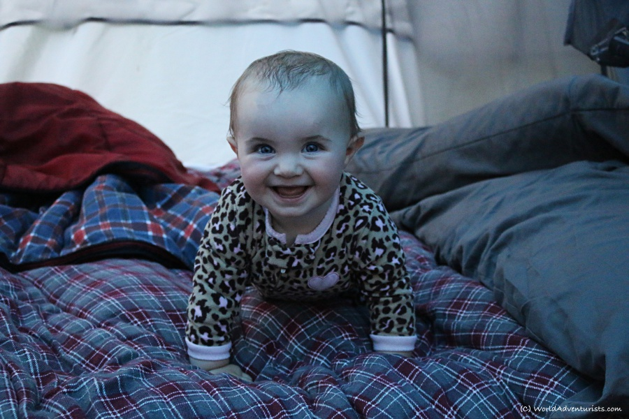 Happy baby camping in a tent at Wells Gray Provincial park