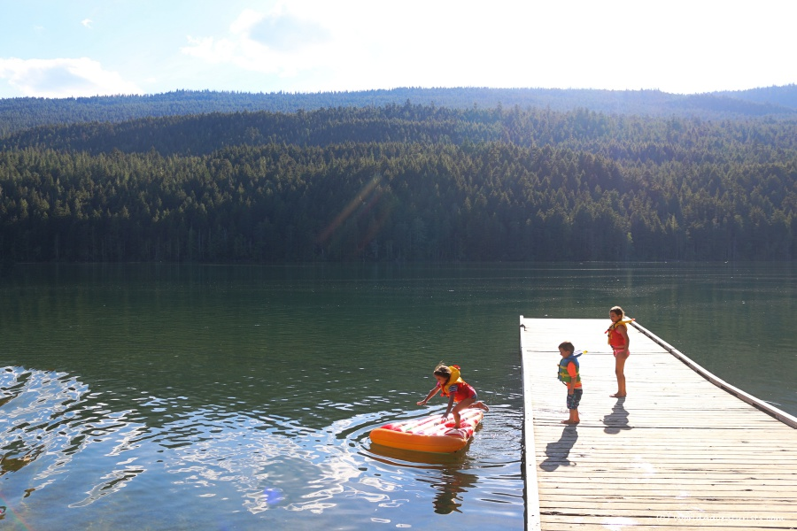 Kids jumping off the dock into Clearwater Lake at Wells Gray Provincial Park