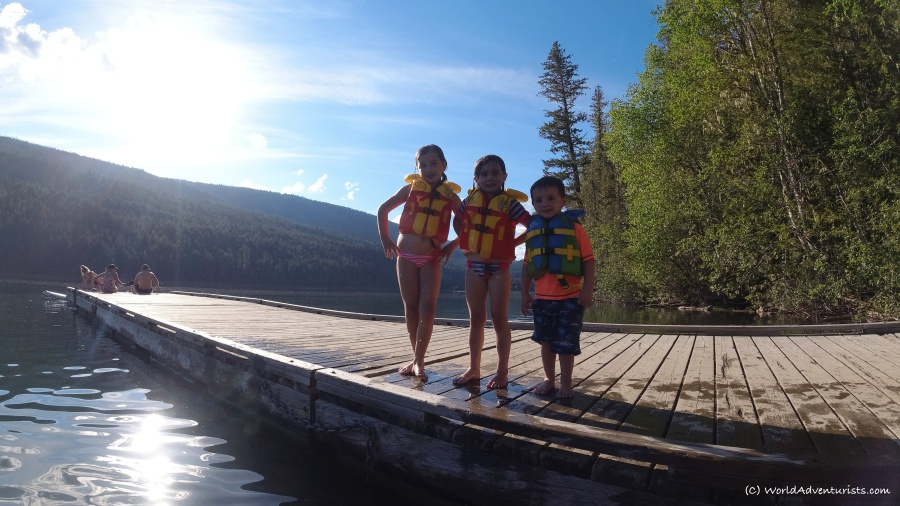 Kids smiling on a dock at Clearwater Lake at Wells Gray Provincial park