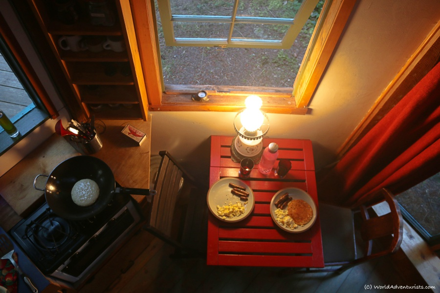 Enjoying breakfast in a rustic cabin in the woods on Galiano Island