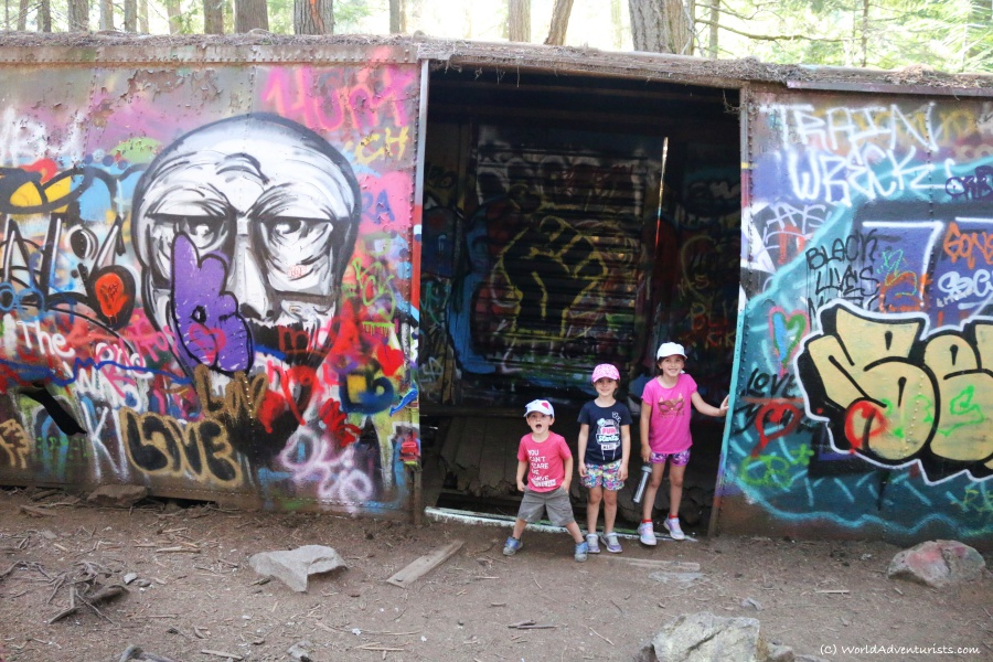 Kids in front of a box car with graffiti